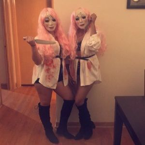 The purge Halloween mask and pink wig